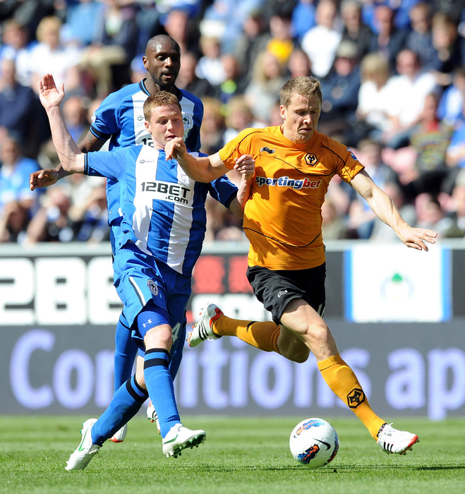 James McCarthy of Wigan Athletic in action with David Edwards of Wolverhampton Wanderers during the Barclays Premier League match between Wigan Athletic and Wolverhampton Wanderers at DW Stadium.