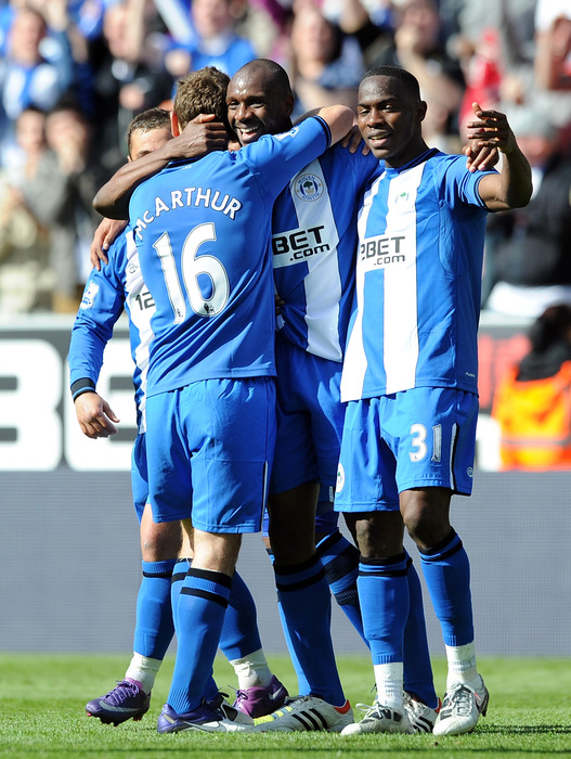 Emmerson Boyce of Wigan Athletic is congratulated by his team-mates after scoring his side's third goal during the Barclays Premier League match between Wigan Athletic and Wolverhampton Wanderers at DW Stadium.