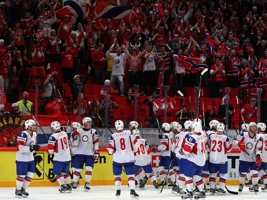 STOCKHOLM, SWEDEN - MAY 13: The team of Norway celebrate with the crowd after the IIHF World Championship group S match between Germany and Norway at Ericsson Globe on May 13, 2012 in Stockholm, Sweden.  (Photo by Martin Rose/Bongarts/Getty Images)