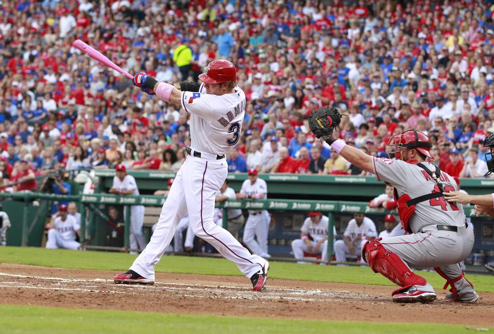 May 13, 2012; Arlington, TX, USA; Texas Rangers center fielder Josh Hamilton (32) strikes out during the first inning of the game against the Los Angeles Angels at Rangers Ballpark. Mandatory Credit: Tim Heitman-US PRESSWIRE