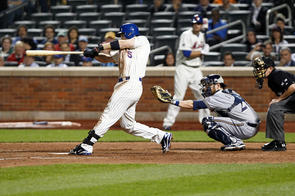 May 14, 2012; Flushing, NY, USA; New York Mets third baseman David Wright (5) doubles to deep right during the eighth inning against the Milwaukee Brewers at Citi Field. Mets won 3-1. Mandatory Credit: Debby Wong-US PRESSWIRE