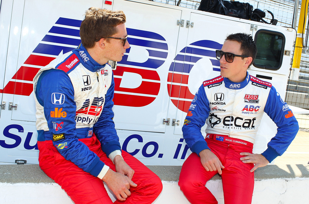 May 15, 2012; Indianapolis, IN, USA; IndyCar series driver Mike Conway and teammate Wade Cunningham talk on pit road before practice for the Indianapolis 500 at the Indianapolis Motor Speedway.  Mandatory Credit: Michael Hickey-US PRESSWIRE