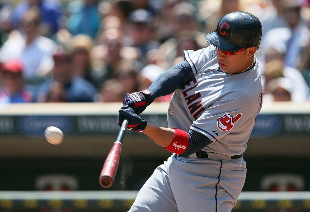 May 15, 2012; Minneapolis, MN, USA: Cleveland Indians shortstop Asdrubal Cabrera (13) hits a home run in the fifth inning against the Minnesota Twins at Target Field. Mandatory Credit: Jesse Johnson-US PRESSWIRE
