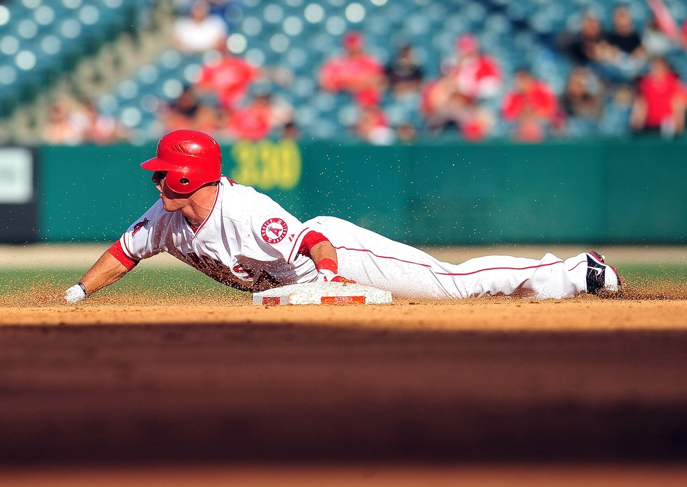 May 15, 2012; Anaheim, CA, USA; Los Angeles Angels center fielder Mike Trout (27) steals second in the fifth inning against the Oakland Athletics at Angel Stadium. Mandatory Credit: Gary A. Vasquez-US PRESSWIRE