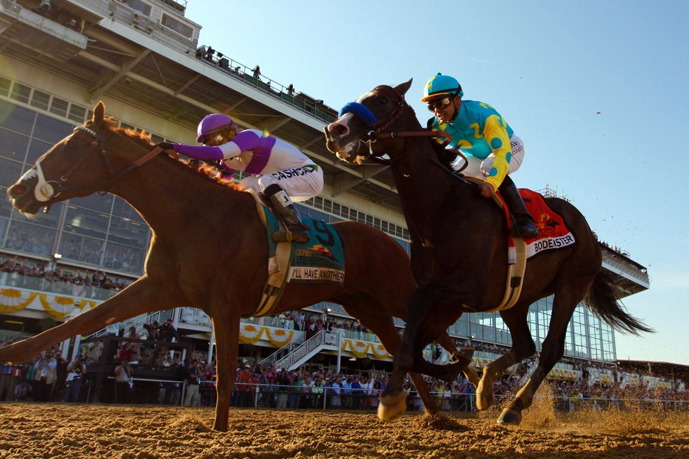 May 19, 2012; Baltimore, MD, USA; Mario Gutierrez aboard I'll Have Another (left) pulls past Mike Smith aboard Bodemeister to win the 137th running of the Preakness Stakes at Pimlico Race Course. Mandatory Credit: Maxwell Kruger-US PRESSWIRE