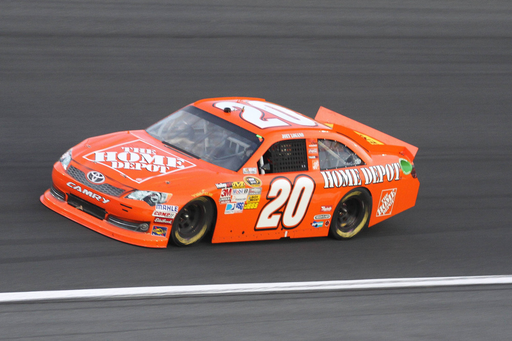 May 19, 2012; Concord, NC, USA Nascar Sprint Cup Series driver Joey Logano (20) drives during the Nascar Sprint Cup Series Showdown at Charlotte Motor Speedway. Mandatory Credit: Jeremy Brevard-US PRESSWIRE