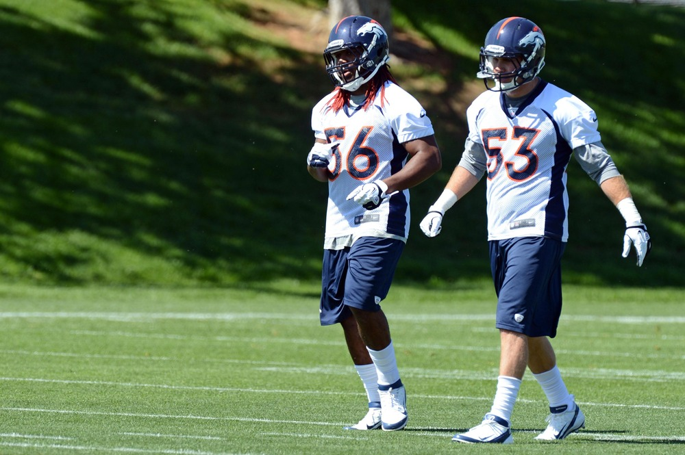 May 21, 2012; Englewood, CO, USA; Denver Broncos middle linebacker Nate Irving (56) and linebacker Mike Mohamed (53) during organized team activities at the Broncos training facility. Mandatory Credit: Ron Chenoy-US PRESSWIRE