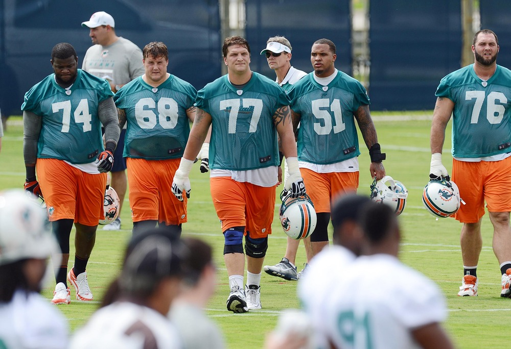 May 22, 2012; Davie, FL, USA; Miami Dolphins offensive tackle Jake Long (77) during organized team activities at the Dolphins training facility. Mandatory Credit: Steve Mitchell-US PRESSWIRE