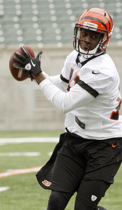 May 22, 2012; Cincinnati, OH USA; Cincinnati Bengals wide receiver A.J. Green (18) catches a pass during organized team activities at Paul Brown Stadium. Mandatory Credit: David Kohl-US PRESSWIRE