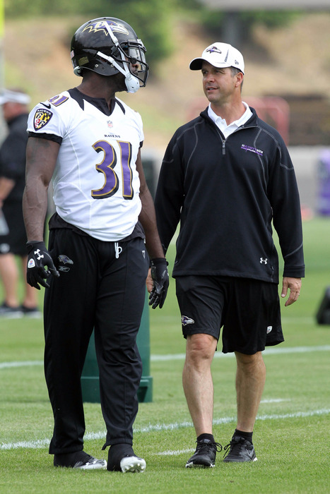 May 23, 2012; Baltimore, MD, USA; Baltimore Ravens head coach John Harbaugh talks with safety Bernard Pollard (31) during an OTA at the team practice facility. Mandatory Credit: Mitch Stringer-US PRESSWIRE