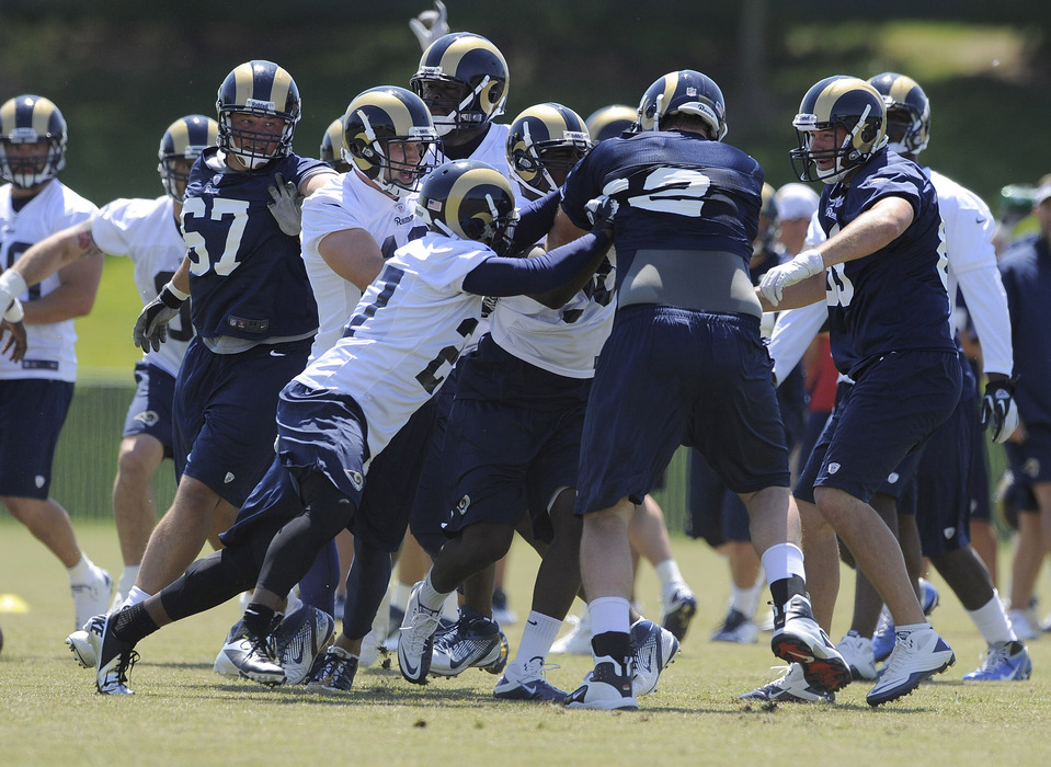 May 23, 2012; St. Louis, MO, USA; St. Louis Rams linebacker Jo-Lonn Dunbar (58) and guard Harvey Dahl (62) scuffle as teammates attempt to break it up during an OTA at ContinuityX Training Center. Mandatory Credit: Jeff Curry-US PRESSWIRE