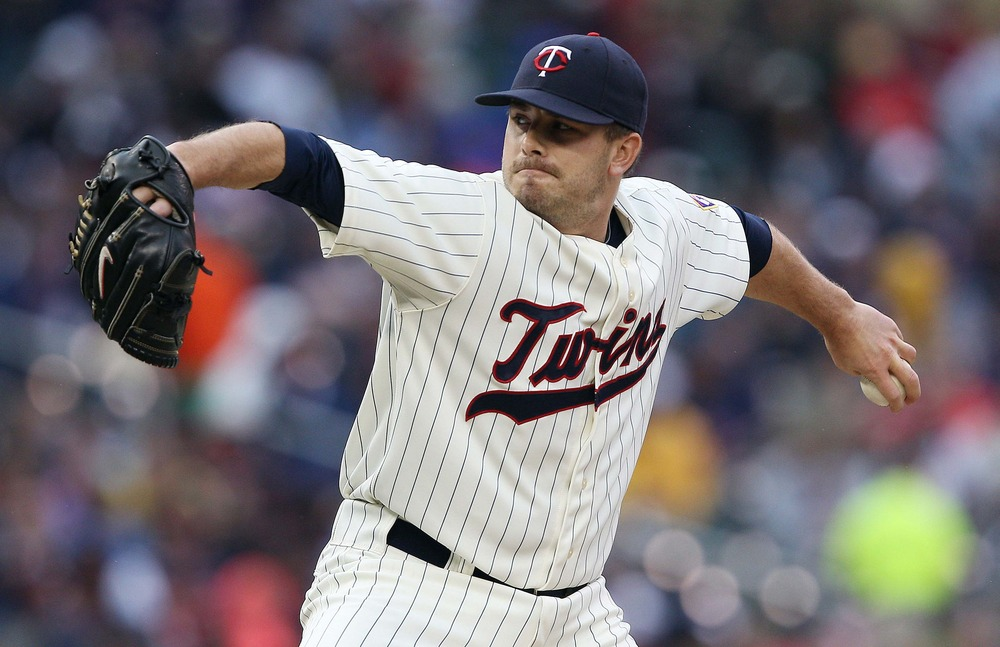 May 26, 2012; Minneapolis, MN, USA: Minnesota Twins starting pitcher Brian Duensing (52) delivers a pitch during the sixth inning against the Detroit Tigers at Target Field. Mandatory Credit: Jesse Johnson-US PRESSWIRE