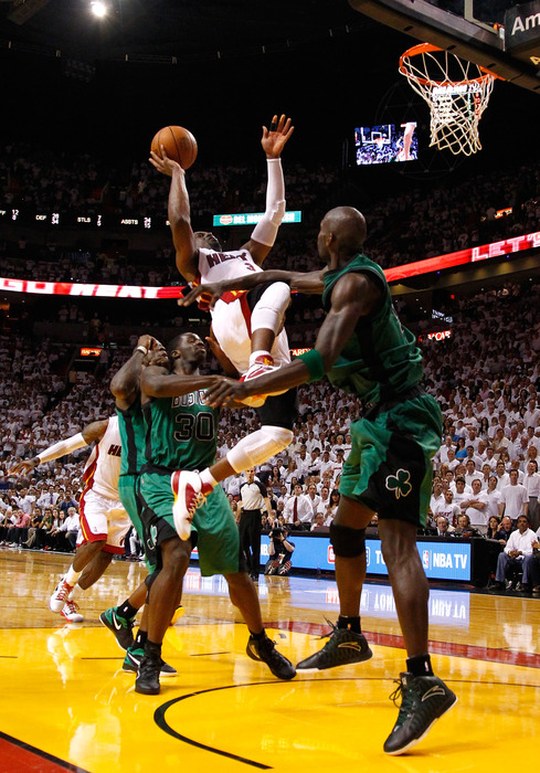 Dwyane Wade, seen here not even bothering to take a realistic shot because he knows he's going to get bailed out.