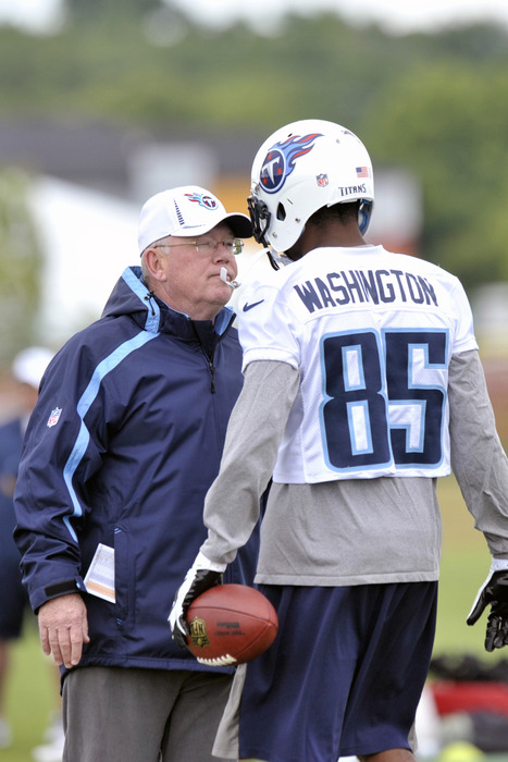 June 1, 2012; Nashville, TN, USA; Tennessee Titans wide receiver Nate Washington (85) talks with offensive coordinator Chris Palmer during OTA at the Titans training facility at Baptist Sports Park. Mandatory Credit: Jim Brown-US PRESSWIRE