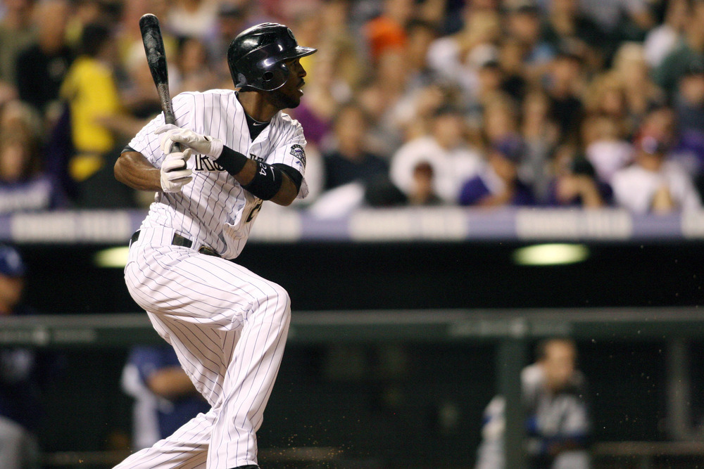 June 1, 2012; Denver, CO, USA; Colorado Rockies center fielder Dexter Fowler (24) hits a double during the sixth inning against the Los Angeles Dodgers at Coors Field.  Mandatory Credit: Chris Humphreys-US PRESSWIRE