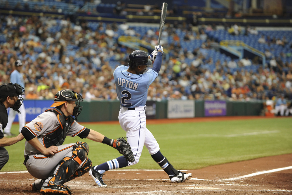 June 3, 2012; Tampa, FL, USA; Tampa Bay Rays center fielder BJ Upton (2) hits a 2-RBI double against the Baltimore Orioles at Tropicana Field.  Mandatory Credit: Jeff Griffith-US PRESSWIRE