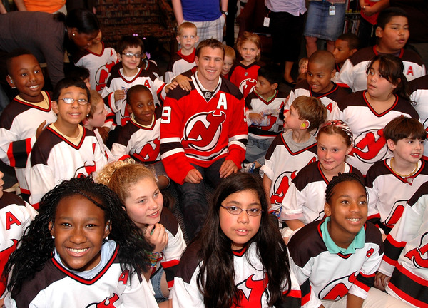Zach Parise bought all of these kids with the advance on his fifty bajillion dollar free agent contract.