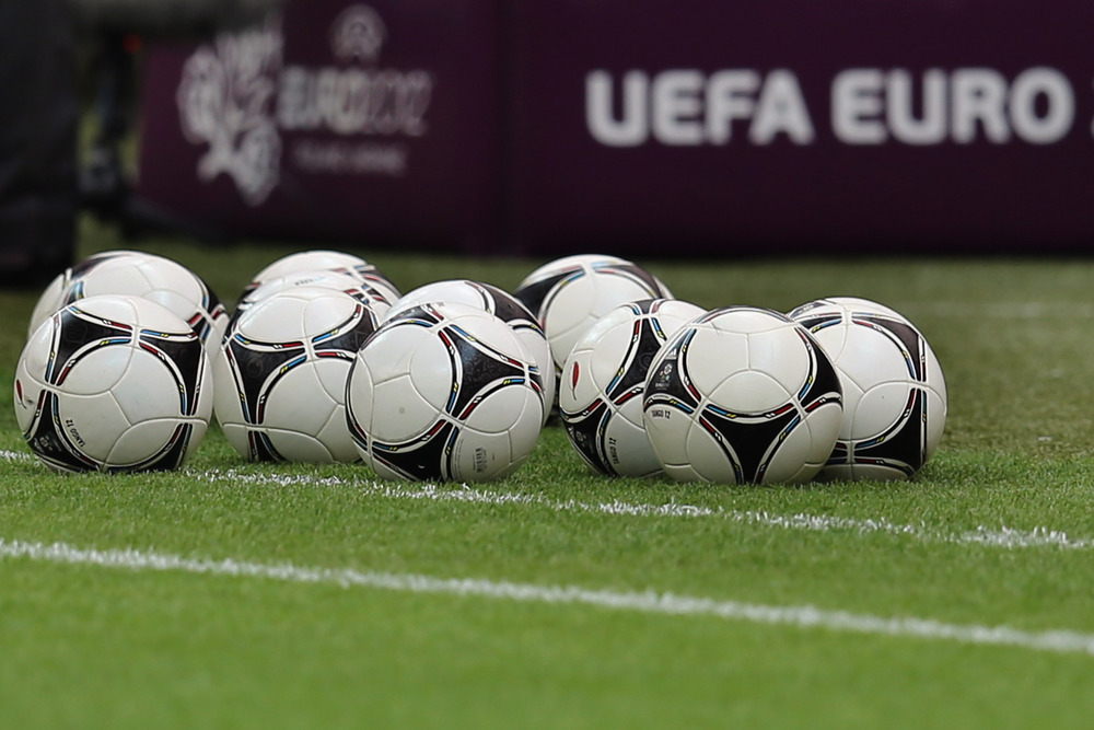 WARSAW, POLAND - JUNE 07: Balls lie on the pitch during a Poland training session ahead of the UEFA EURO 2012 Group A match against Greece at National Stadium on June 7, 2012 in Warsaw, Poland.  (Photo by Alex Grimm/Getty Images)