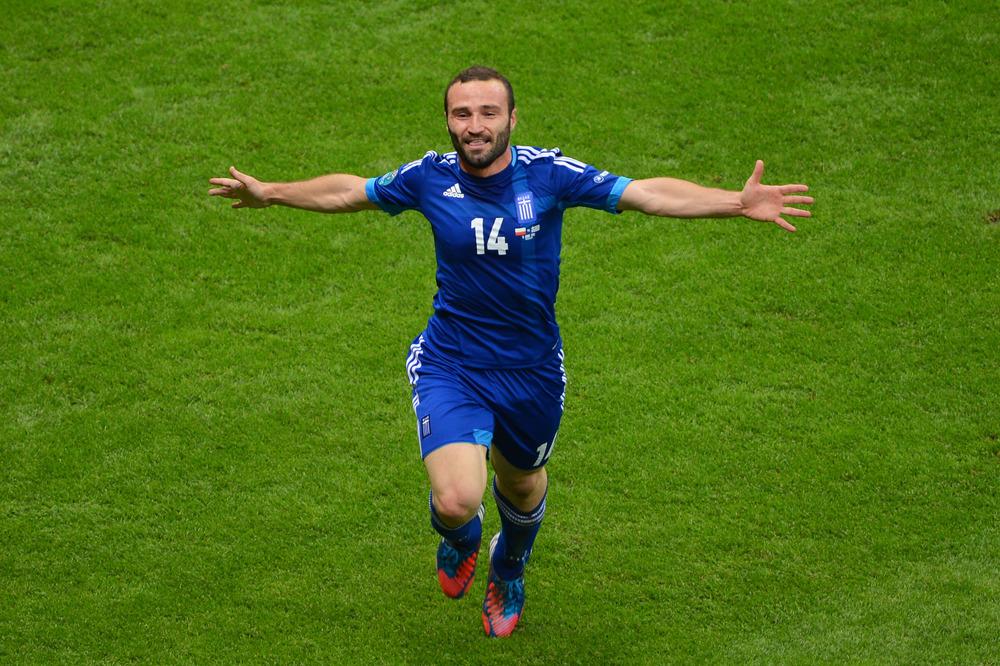 Dimitris Salpigidis of Greece celebrates scoring their first goal during the UEFA EURO 2012 group A match between Poland and Greece at The National Stadium.