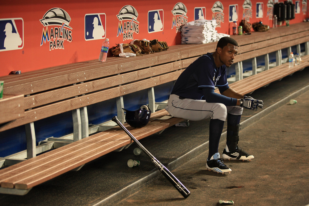 MIAMI, FL - JUNE 09:  B.J. Upton #2 of the Tampa Bay Rays looks on from the dugout against the Miami Marlins at Marlins Park on June 9, 2012 in Miami, Florida.  (Photo by Chris Trotman/Getty Images)
