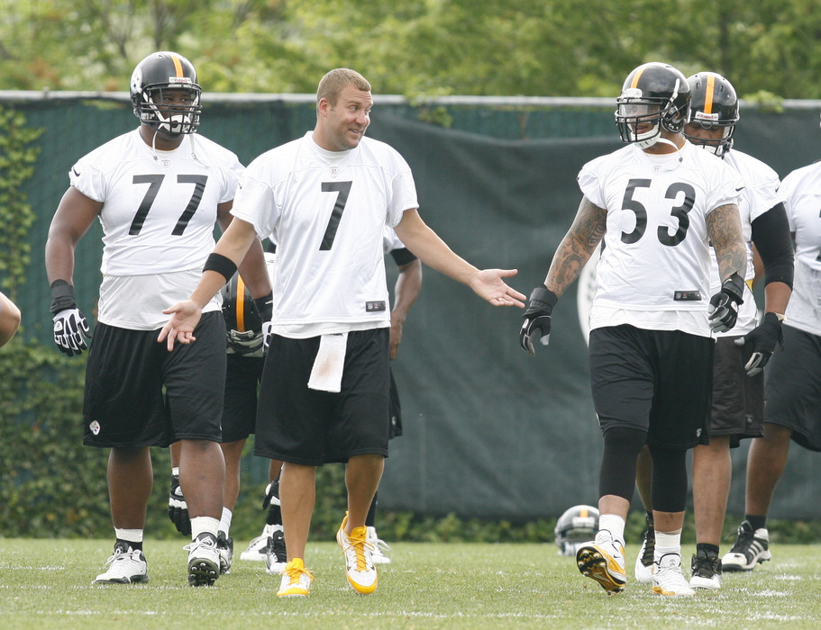 June 12, 2012; Pittsburgh, PA, USA; Pittsburgh Steelers quarterback Ben Roethlisberger (7) talks to center Maurkice Pouncey (53) as they stretch during minicamp at the UPMC Sports Performance Complex. Mandatory Credit: Charles LeClaire-US PRESSWIRE