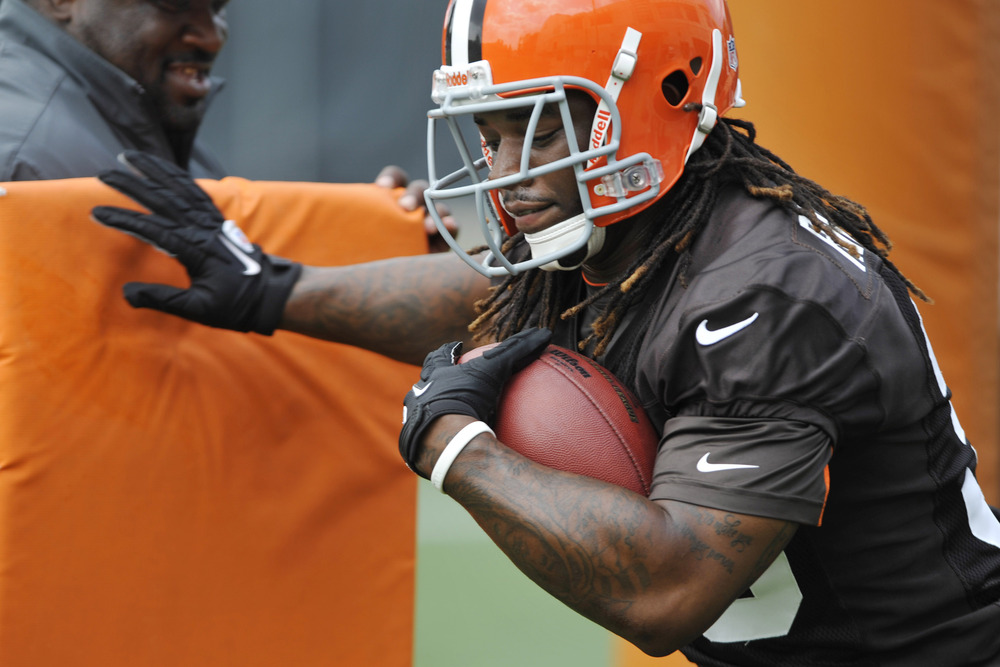 Jun 12, 2012; Berea, OH, USA; Cleveland Browns running back Trent Richardson (33) works beside running backs coach Gary Brown during minicamp at the Cleveland Browns training facility. Mandatory Credit: David Richard-US PRESSWIRE