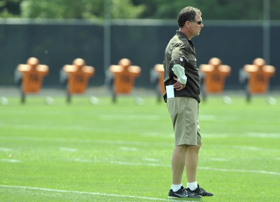 Jun 12, 2012; Berea, OH, USA; Cleveland Browns head coach Pat Shurmur watches his squad during minicamp at the Cleveland Browns training facility. Mandatory Credit: David Richard-US PRESSWIRE