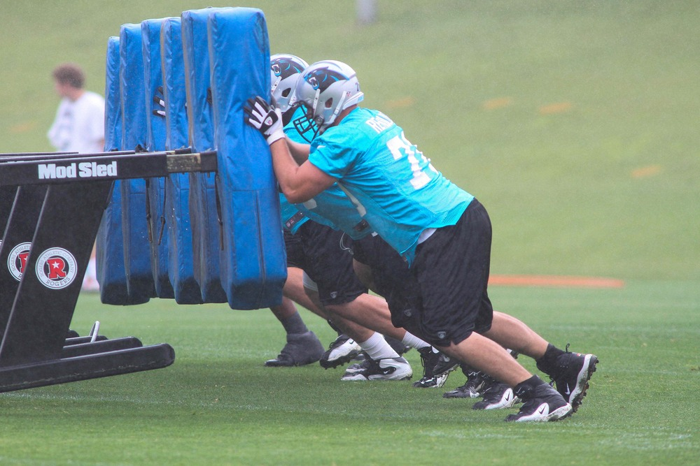 Jun 12, 2012; Charlotte, NC, USA Carolina Panthers offensive line pushes the sled during minicamp at the team's practice facility at Bank of America Stadium. Mandatory Credit: Jeremy Brevard-US PRESSWIRE