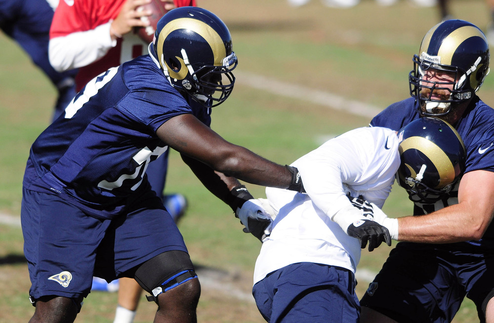 June 12, 2012; St. Louis, MO, USA; St. Louis Rams tackle Barry Richardson (79) defends against defensive end Chris Long (91) during minicamp at ContinuityX Training Center. Mandatory Credit: Jeff Curry-US PRESSWIRE