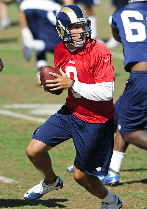 June 12, 2012; St. Louis, MO, USA; St. Louis Rams quarterback Sam Bradford (8) throws during minicamp at ContinuityX Training Center. Mandatory Credit: Jeff Curry-US PRESSWIRE