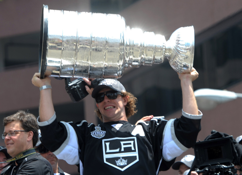 Jun 14, 2012; Los Angeles, CA, USA; Los Angeles Kings center Anze Kopitar holds the 2012 Stanley Cup at the Los Angeles Kings victory celebration parade. Mandatory Credit: Kirby Lee/Image of Sport-US PRESSWIRE
