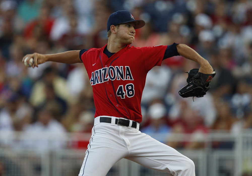 June 17, 2012; Omaha, NE, USA;  Arizona Wildcats pitcher Konner Wade (48) throws against the UCLA Bruins during the second inning of game six of the 2012 College World Series at TD Ameritrade Park. Mandatory Credit: Bruce Thorson-US PRESSWIRE