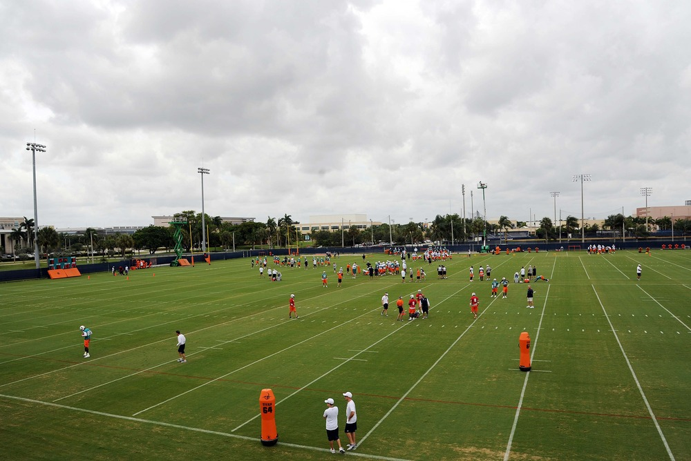 June 19, 2012; Davie, FL, USA; A general view of Miami Dolphins players practicing during mini camp at the Dolphins training facility. Mandatory Credit: Steve Mitchell-US PRESSWIRE