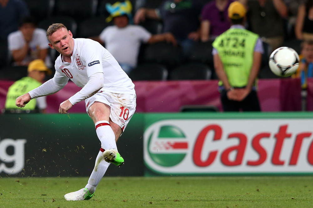 DONETSK, UKRAINE - JUNE 19:  Wayne Rooney of England crosses the ball during the UEFA EURO 2012 group D match between England and Ukraine at Donbass Arena on June 19, 2012 in Donetsk, Ukraine.  (Photo by Alex Livesey/Getty Images)
