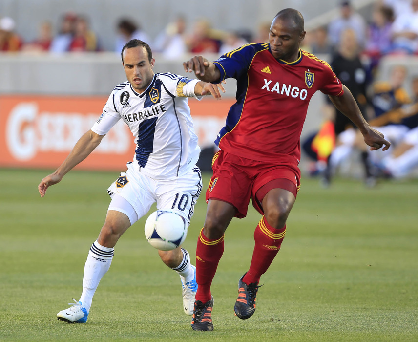 SANDY, UT - JUNE 20: Landon Donovan #10 of Los Angeles Galaxy and Real Salt Lake's Jamison Olave #4 fights for the ball during the first half of an MLS soccer game June 20, 2012 at Rio Tinto Stadium in Sandy, Utah. (Photo by George Frey/Getty Images)
