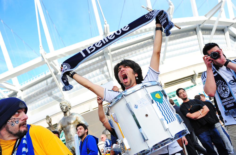 VANCOUVER, CANADA - JUNE 20:  A Vancouver Whitecaps fan cheers on his team prior to their game against the New York Red Bulls at B.C. Place on June 20, 2012 in Vancouver, British Columbia, Canada. (Photo by Jessica Haydahl/Getty Images)