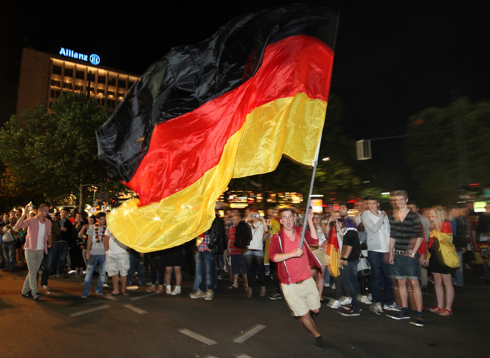 BERLIN, GERMANY - JUNE 22:  German soccer fans celebrate their team at Kurfuerstendamm after the UEFA Euro 2012 quarter final match between Germany and Greece on June 22, 2012 in Berlin, Germany.  (Photo by Matthias Kern/Getty Images,)