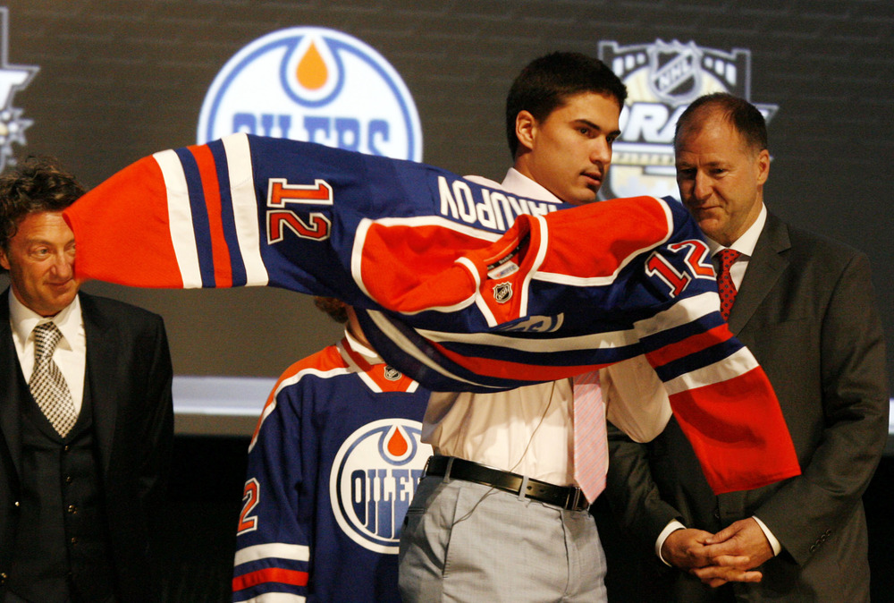 June 22, 2012; Pittsburgh, PA, USA; Nail Yakupov puts on an Oilers jersey after being selected as the number one overall draft pick to the Edmonton Oilers in the 2012 NHL Draft at CONSOL Energy Center.  Mandatory Credit: Charles LeClaire-US PRESSWIRE