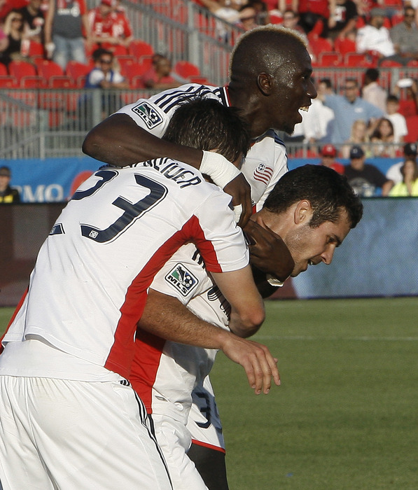 TORONTO, CANADA - JUNE 23: The New England Revolution celebrates a Chris Tierney goal at BMO Field June 23, 2012 in Toronto, Ontario, Canada.  (Photo by Abelimages/Getty Images)
