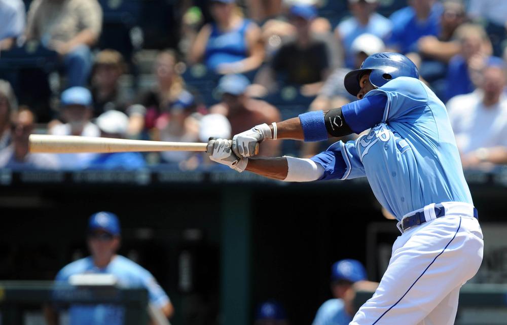 Jun 27, 2012; Kansas City, MO, USA; Kansas City Royals shortstop Alcides Escobar (2) hits a home run in the third inning against the Tampa Bay Rays at Kauffman Stadium. Mandatory Credit: John Rieger-US PRESSWIRE
