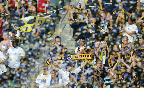 CARSON, CA - JUNE 5:   Los Angeles Galaxy fans celebrate as the game ends with the Houston Dynamo on June 5, 2010 at the Home Depot Center in Carson, California. The Galaxy won 4-1.  (Photo by Stephen Dunn/Getty Images)