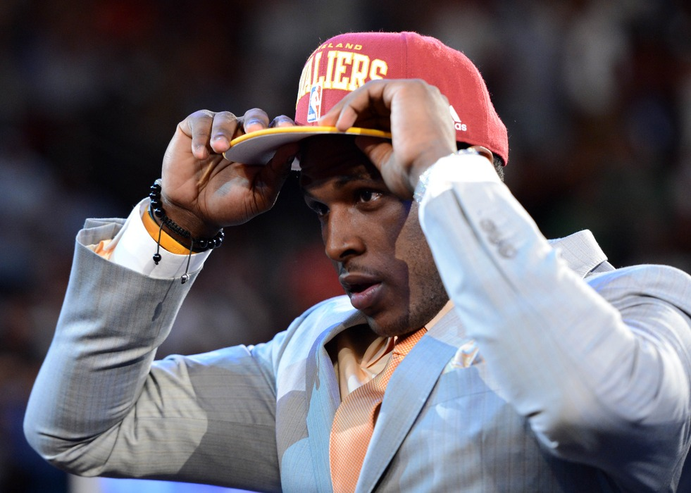 June 28, 2012; Newark, NJ, USA; Dion Waiters (Syracuse) puts on a cap as he is introduced as the number four overall pick to the Cleveland Cavaliers during the 2012 NBA Draft at the Prudential Center.  Mandatory Credit: Jerry Lai-US PRESSWIRE