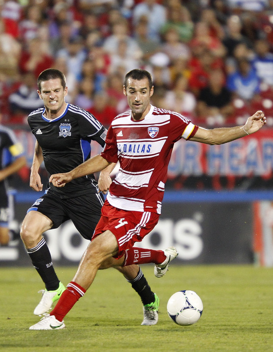 FRISCO, TX - JULY 7: Andrew Jacobson #4 of FC Dallas passes the ball away from Sam Cronin #4 of San Jose Earthquakes at FC Dallas Stadium on July 7, 2012 in Frisco, Texas. (Photo by Rick Yeatts/Getty Images)