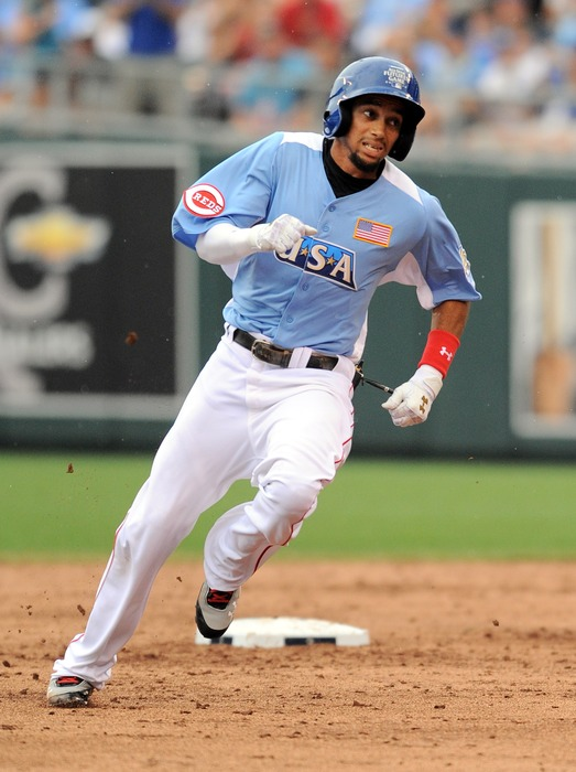 July 8, 2012; Kansas City, MO, USA; USA player Billy Hamilton heads to third base on his two-run triple during the third inning of the 2012 All Star Futures Game at Kauffman Stadium.  Mandatory Credit: Denny Medley-US PRESSWIRE