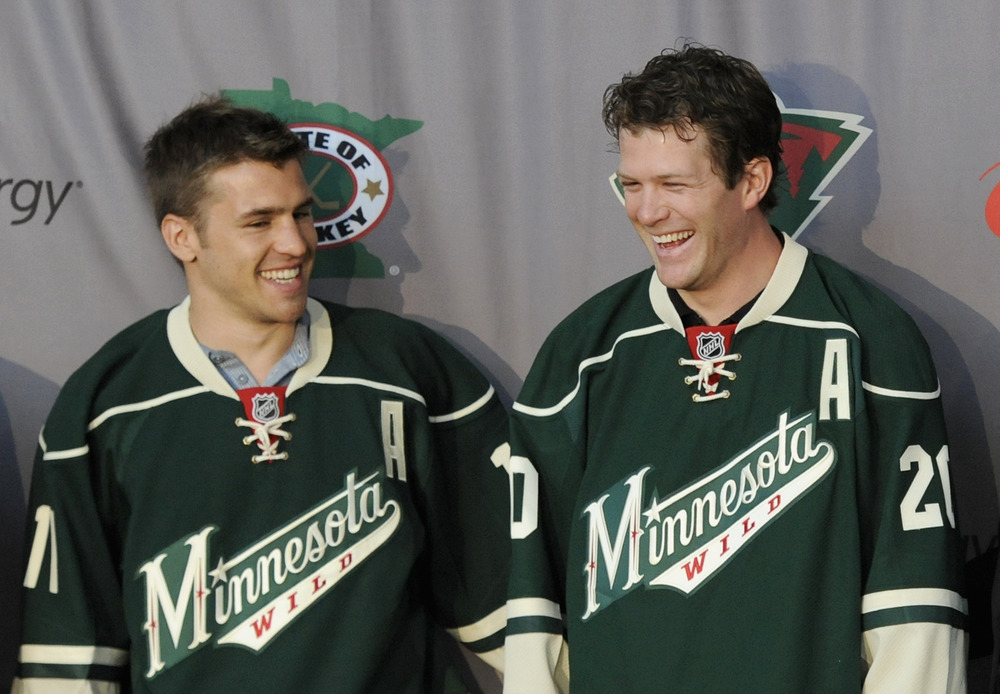 ST PAUL, MN - JULY 9: Zach Parise #11 and Ryan Suter #20 of the Minnesota Wild are introduced during press conference on July 9, 2012 at Xcel Energy Center in St Paul, Minnesota. (Photo by Hannah Foslien/Getty Images)
