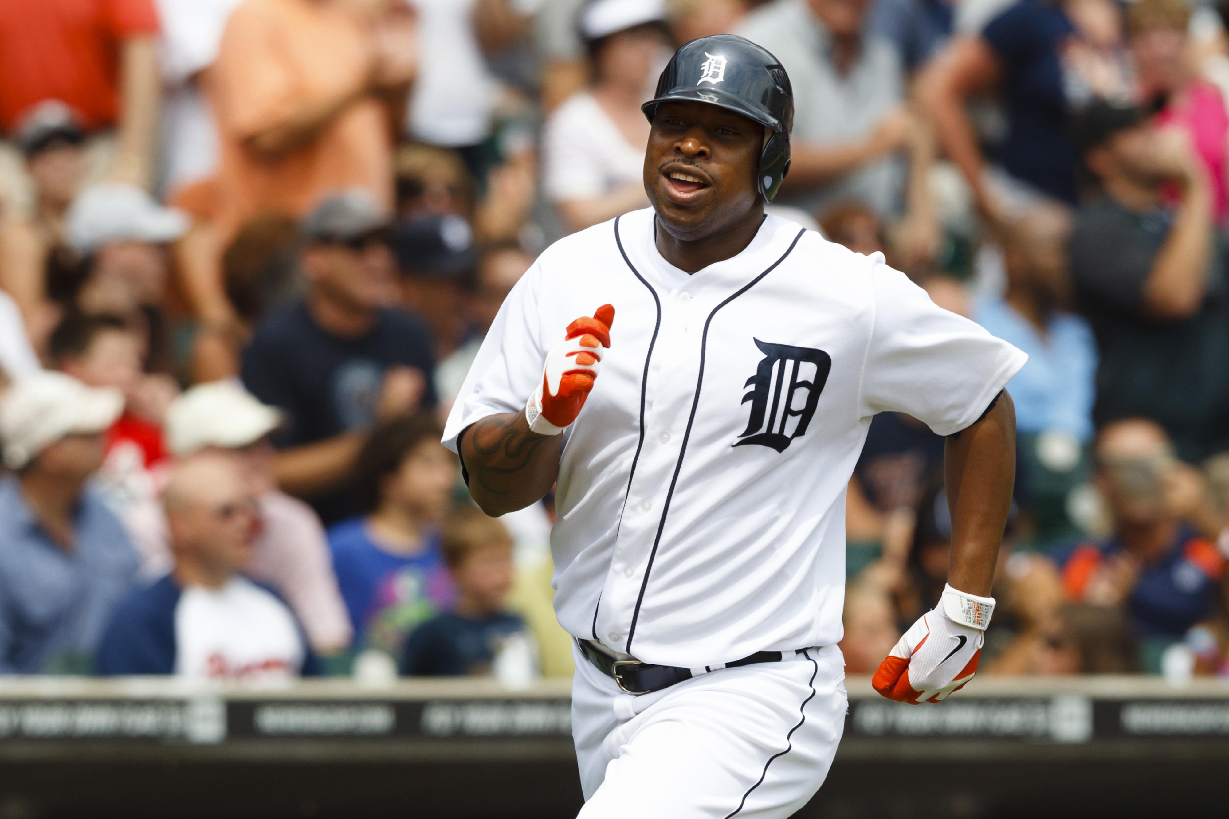 July 8, 2012; Detroit, MI, USA; Detroit Tigers designated hitter Delmon Young (21) scores a run against the Kansas City Royals at Comerica Park. Mandatory Credit: Rick Osentoski-US PRESSWIRE