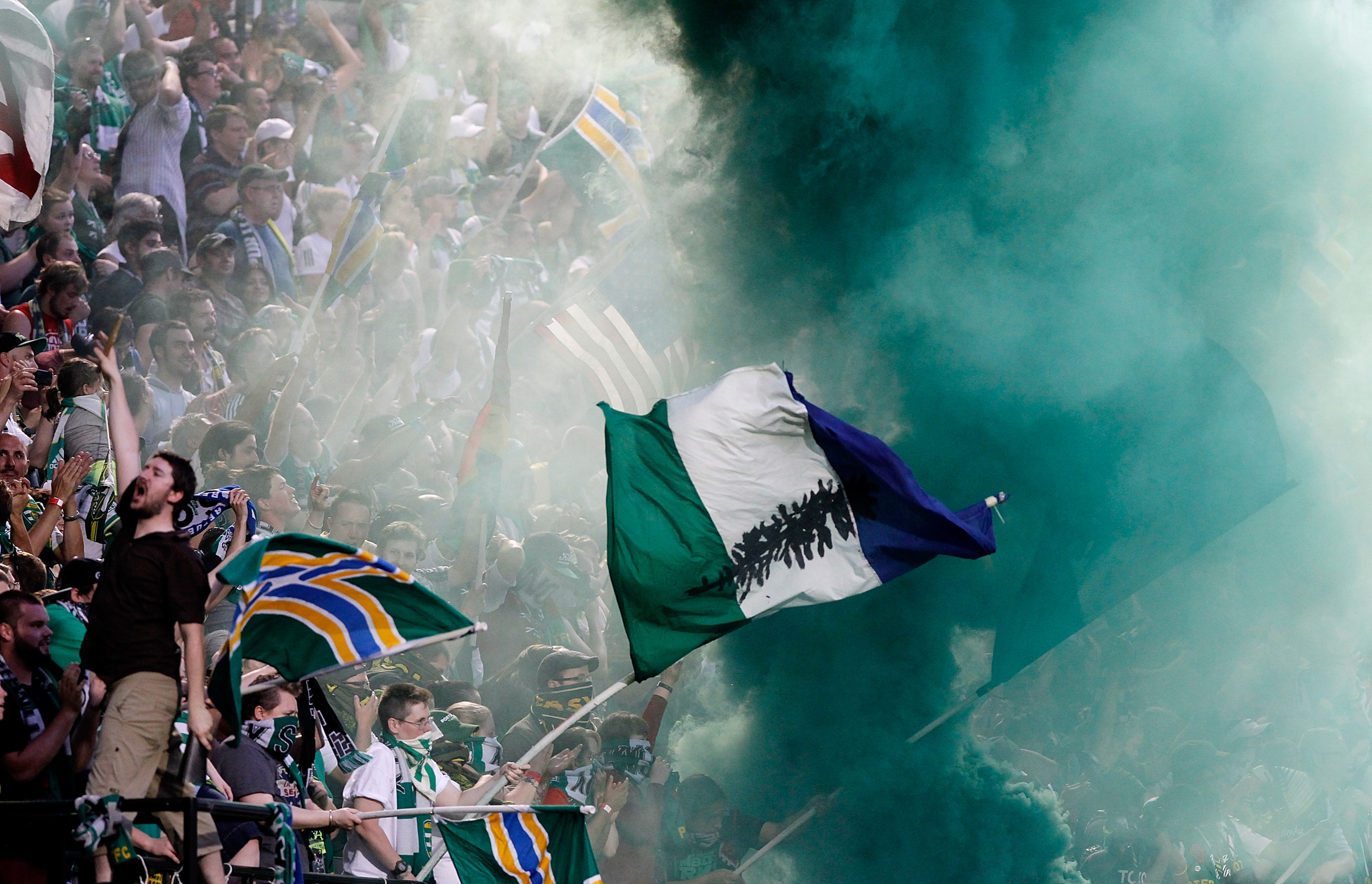 PORTLAND, OR - JULY 14:  Fans of the Portland Timbers celebrate a goal against the Los Angeles Galaxy on July 14, 2012 at Jeld-Wen Field in Portland, Oregon.  (Photo by Jonathan Ferrey/Getty Images)