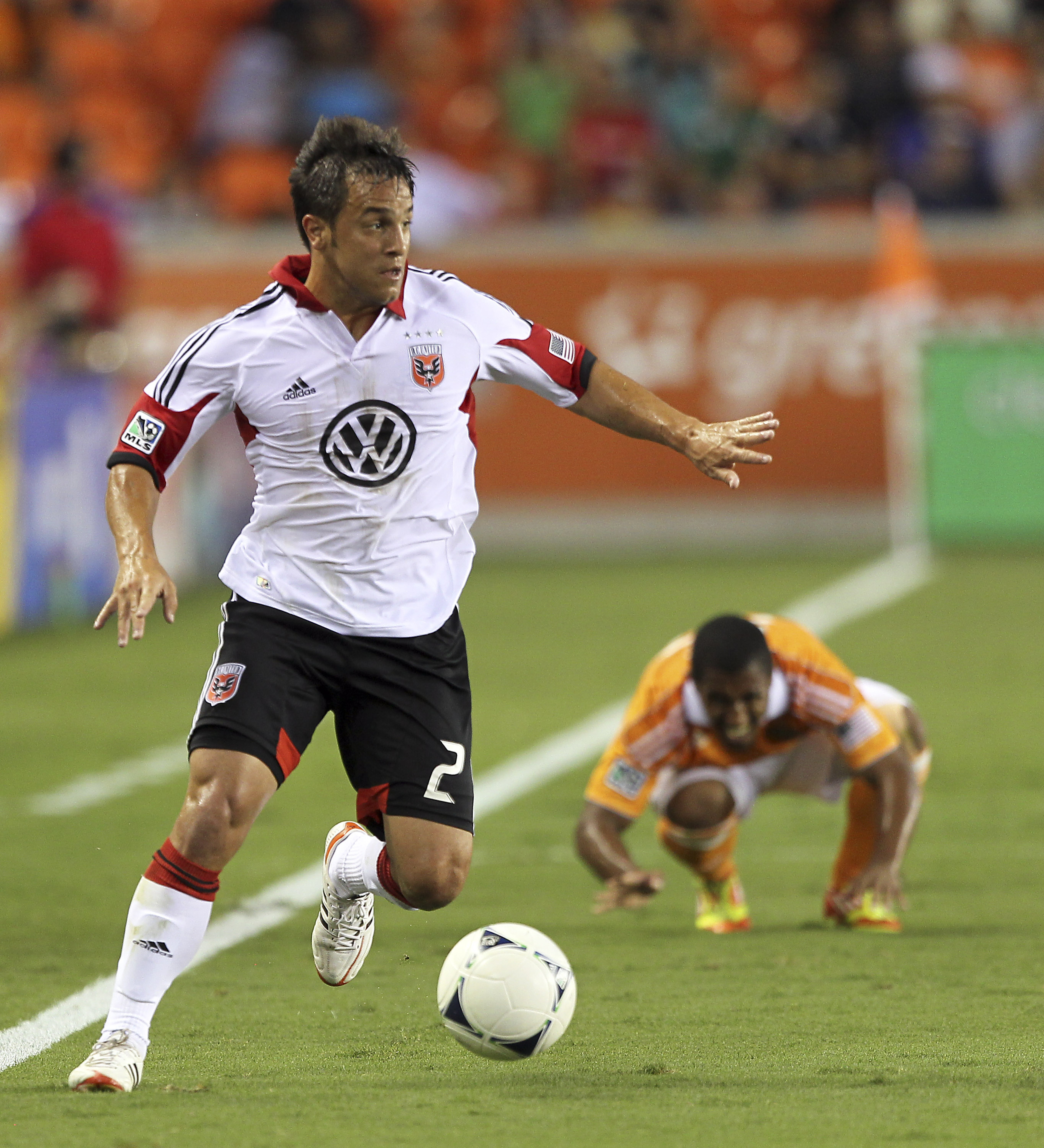 HOUSTON, TX - JULY 15:   Danny Cruz #2 of the D.C. United looks for a teammate to pass to against the Houston Dynamo at BBVA Compass Stadium on July 15, 2012 in Houston, Texas. (Photo by Bob Levey/Getty Images)