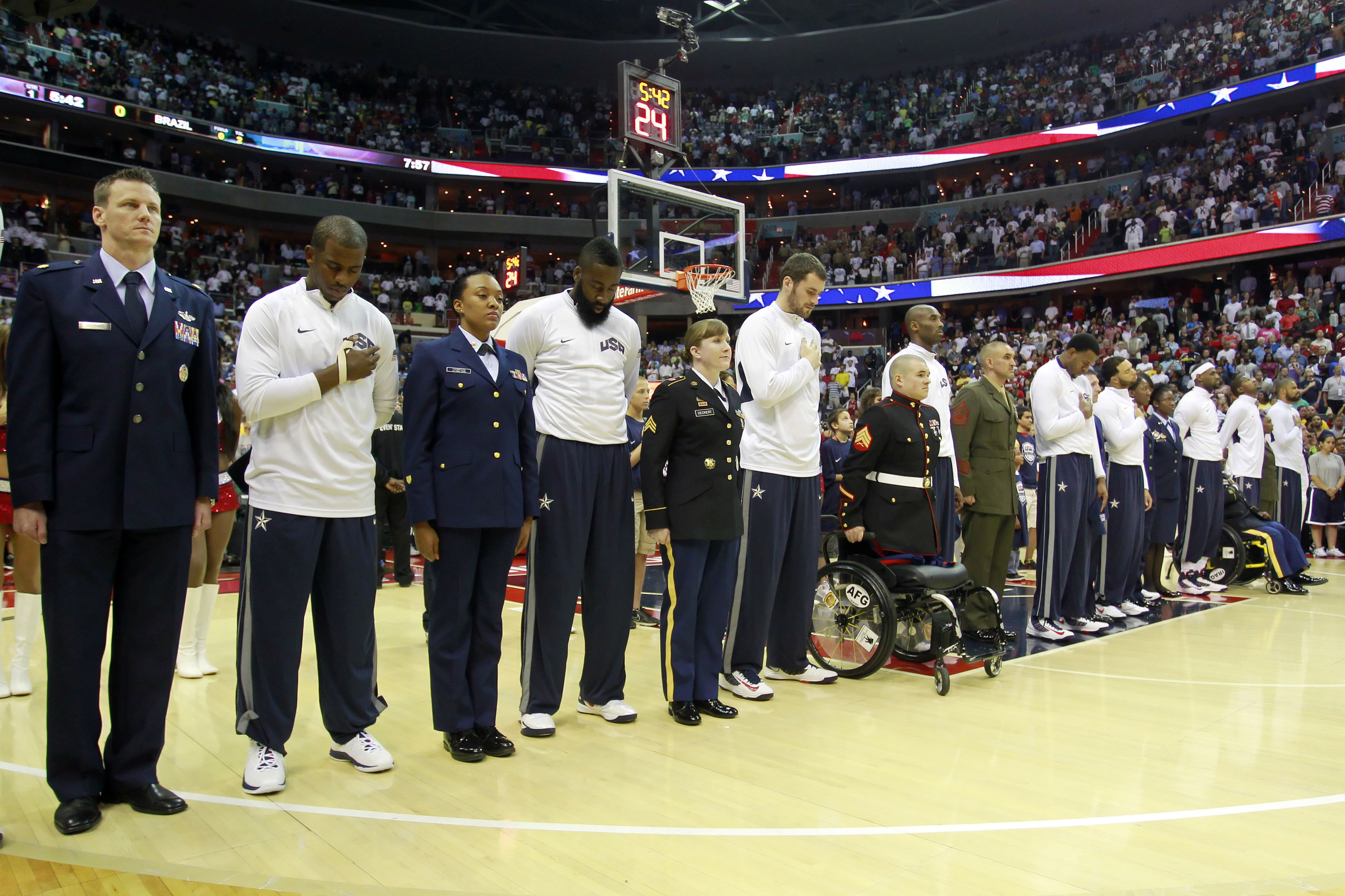 July 16, 2012; Washington, DC, USA; Members of team USA stand with servicemen and servicewomen during the national anthem prior to team USA's game against team Brazil at Verizon Center. Team USA won 80-69. Mandatory Credit: Geoff Burke-US PRESSWIRE