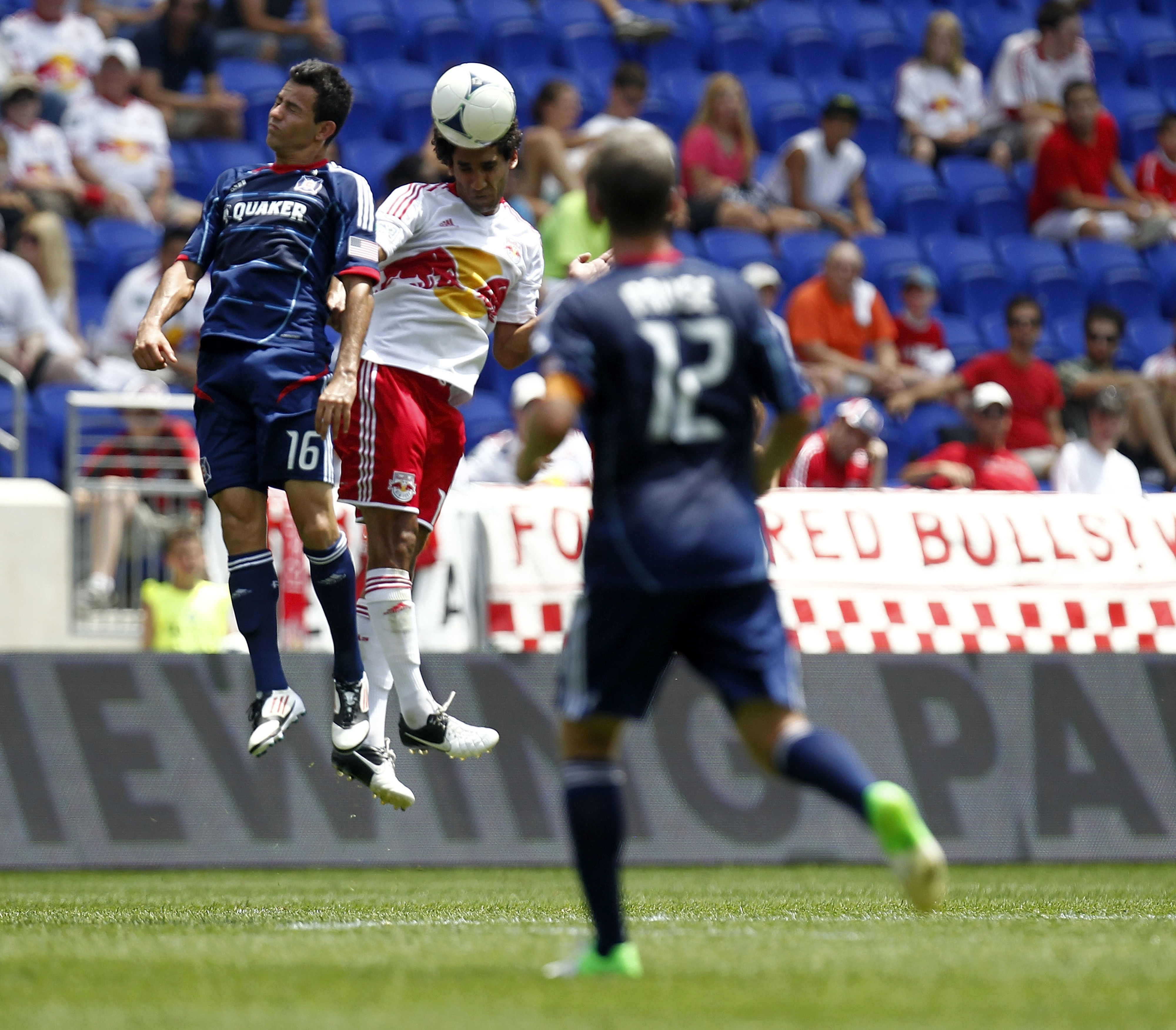 HARRISON, NJ - JULY 18:  Mehdi Ballouchy #10 of the New York Red Bulls and Marco Pappa #16 of the Chicago Fire fight for the ball during their match at Red Bull Arena on July 18, 2012 in Harrison, New Jersey.  (Photo by Jeff Zelevansky/Getty Images)